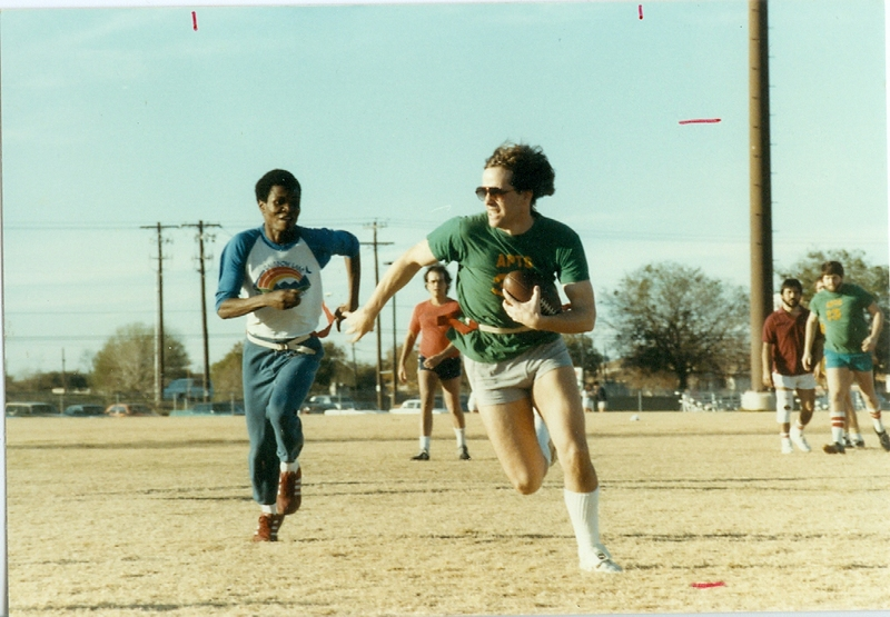 An APTS student runs with the ball in a 1980s Polity Bowl